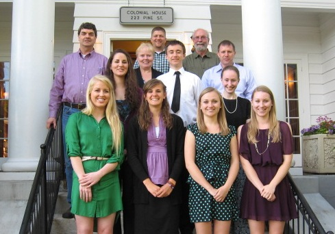 Reed scholarship winners gathered at the Colonial House.  Left to right, front row: Lacey Schauberger, Madilyn Sayler, Sarah Myers, Kathryn Myers. 2nd row: Laurel Gordon, Sam Baderdeen, Tessa Blackstad. Back row:  Mark E. Reed Scholarship Board Members Kevin Lyle, Diana Goldy, Jason Goldsby, Skip Morrison and John Ison. Stephanie Howard, scholarship winner, is not pictured.
