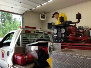 A Fire District 4 firefighter conducting an inventory check prior to mobilization