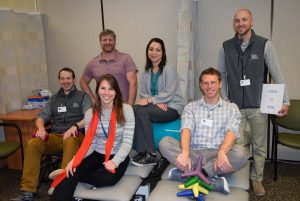 New hires (front, l-r) Erika Feitz, physical therapist; Jeff Frisse, physical therapist; (back, l-r) Keith Schmidt, physical therapist; Larry Messenger, physical therapist; Nicole Jaramillo, occupational therapist assistant, and Tyler Dunnington, office assistant.